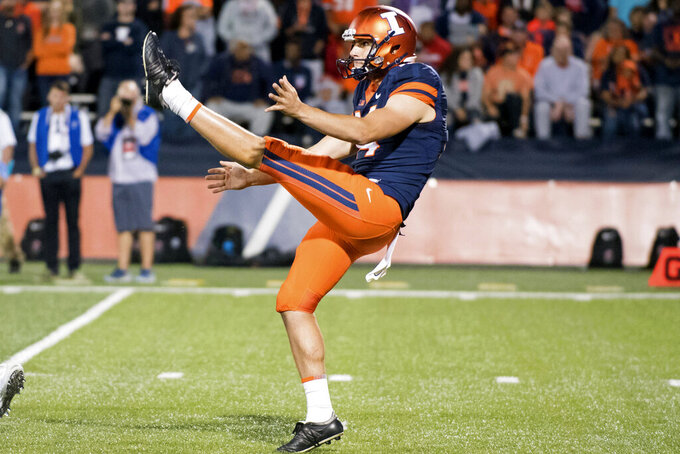 FILE - In this Sept. 9, 2017, file photo, Illinois punter Blake Hayes (14) punts the ball during an NCAA college football game against Western Kentucky, in Champaign, Ill. The Big Ten Conference knows the value of having good punters, and they are sometimes willing to go a long way to get them. Hayes is a former Australian rules football player who trained at ProKick Australia before coming to the United States.  (AP Photo/Bradley Leeb, File)