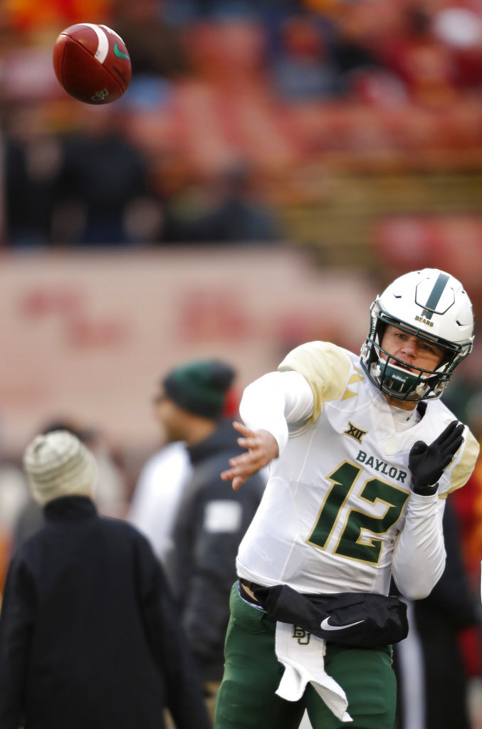 Baylor quarterback Charlie Brewer warms up before an NCAA college football game against Iowa State, Saturday, Nov. 10, 2018, in Ames. (AP Photo/Matthew Putney)