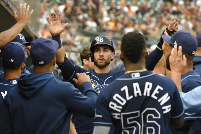 Tampa Bay Rays' Kevin Kiermaier, middle, is congratulated after scoring a run against the Detroit Tigers duirng the second inning of a baseball game Saturday, Sept. 11, 2021, in Detroit. (AP Photo/Jose Juarez)