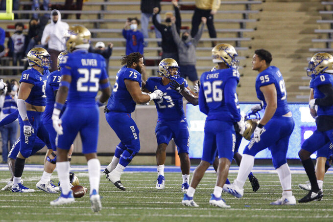 Tulsa celebrates after linebacker Zaven Collins (23) made a winning interception against SMU during the second half of an NCAA college football game in Tulsa, Okla., Saturday, Nov. 14, 2020. (AP Photo/Joey Johnson)