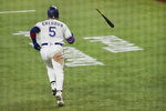 Texas Rangers designated hitter Willie Calhoun tosses the bat away after hitting a home run in the sixth inning of a baseball game against the Boston Red Sox in Arlington, Texas, Saturday, May 1, 2021. (AP Photo/Louis DeLuca)