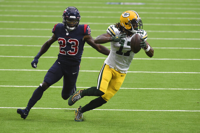 Green Bay Packers wide receiver Davante Adams (17) runs for the end zone past Houston Texans safety Eric Murray (23) after catching a pass for a touchdown during the second half of an NFL football game Sunday, Oct. 25, 2020, in Houston. (AP Photo/Eric Christian Smith)
