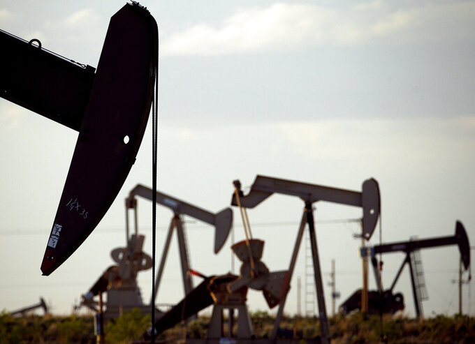 FILE - In this April 24, 2015, file photo, pumpjacks work in a field near Lovington, N.M. New Mexico is now the nation's second largest oil producing state, and environmental regulators say more needs to be done to rein in pollution from the industry. (AP Photo/Charlie Riedel, File)