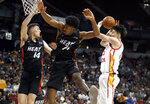 China's Zhou Qi, right, tries to shoot as Miami Heat's Tyler Herro (14) and Kyle Alexander (74) defend during an NBA summer league basketball game Friday, July 5, 2019, in Las Vegas. (AP Photo/Steve Marcus)