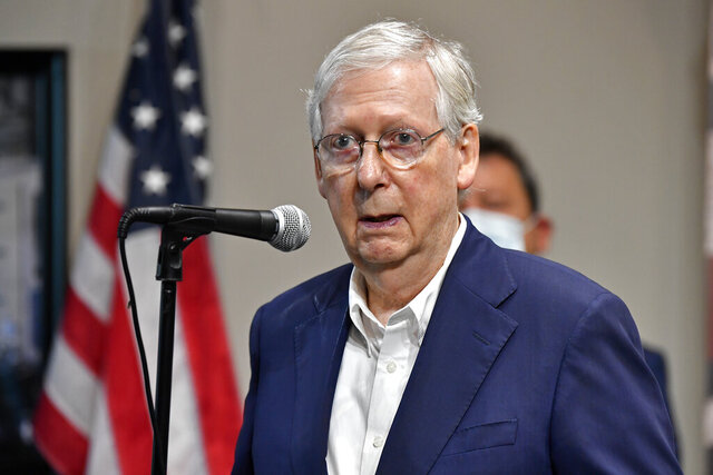 Senate Majority Leader Mitch McConnell, R-Ky., speaks with reporters during a visit to the Boundary Oak Distillery in Radcliff, Ky., Wednesday, Aug. 19, 2020. (AP Photo/Timothy D. Easley)