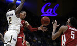 Washington State's Jervae Robinson, center, passes the ball away from California's Juhwan Harris-Dyson (2) to Marvin Cannon (5) in the second half of an NCAA college basketball game Saturday, March 2, 2019, in Berkeley, Calif. (AP Photo/Ben Margot)
