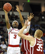 Mississippi's Terence Davis (3) shoots over Oklahoma's Brady Manek (35) during a first-round game in the NCAA men's college basketball tournament in Columbia, S.C. Friday, March 22, 2019. (AP Photo/Richard Shiro)