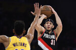 FILE - In this April 9, 2019, file photo, Portland Trail Blazers guard Seth Curry shoots as Los Angeles Lakers forward Johnathan Williams defends during the first half of an NBA basketball game in Los Angeles. Seth Curry is returning to Dallas as a free agent after a year away. Two people with knowledge of the deal say Stephen Curry's younger brother and the Mavericks have agreed on a $32 million, four-year contract. The people spoke to The Associated Press on condition of anonymity because deals can't be signed until Saturday. (AP Photo/Mark J. Terrill, File)