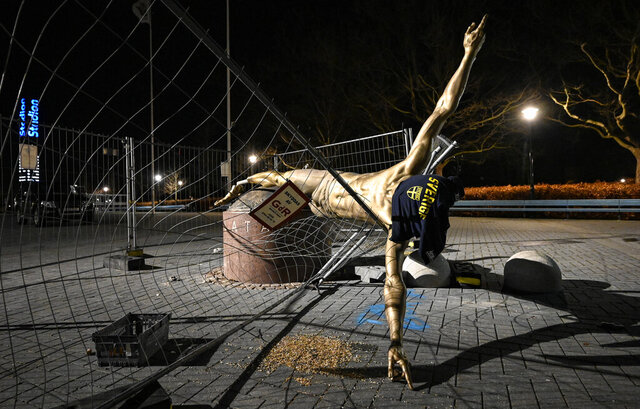 """The damaged statue of soccer player Zlatan Ibrahimovic next to Stadion football arena in Malmo, Sweden, Sunday Jan. 5, 2020. Ibrahimovic, who recently joined Italian side AC Milan, angered fans of his boyhood club, Malmo, in November when he bought a stake in one of Swedish title rivals, Hammarby, and outlined his desire to make the Stockholm-based team """"the best in Scandinavia"""