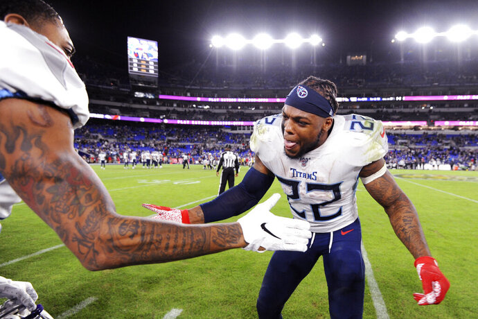 Tennessee Titans running back Derrick Henry (22) celebrates during the second half of an NFL divisional playoff football game against the Baltimore Ravens, Saturday, Jan. 11, 2020, in Baltimore. The Titans won 28-12. (AP Photo/Gail Burton)