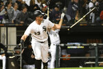 Chicago White Sox's James McCann (33) watches his three-run home run against the Cleveland Indians during the fourth inning of a baseball game Thursday, Sept. 26, 2019, in Chicago. (AP Photo/David Banks)