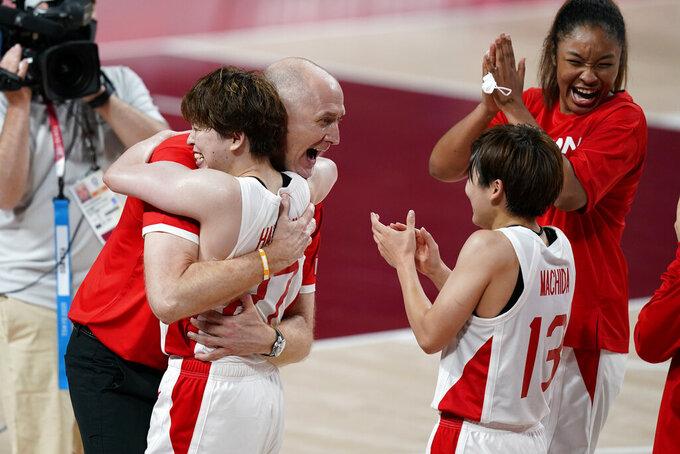 Japan head coach Thomas Hovasse hugs Saki Hayashi after a women's basketball quarterfinal round game against Belgium at the 2020 Summer Olympics, Wednesday, Aug. 4, 2021, in Saitama, Japan. (AP Photo/Charlie Neibergall)