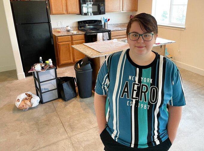 Olivia Kilfoyle stands in her new apartment in Ogden, Utah, on Thursday, May 20, 2021, thanks to assistance from an injection of federal COVID-19 relief funds meant to help those in the foster care system or those who have recently aged out of it. (Tim Vandenack/Standard-Examiner via AP)