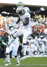 South Florida's Darnell Salomon, front, celebrates his touchdown against Illinois with teammate Randall St. Felix during the second half of an NCAA college football game Saturday, Sept. 15, 2018, in Chicago. (AP Photo/Jim Young)