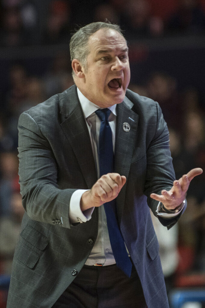 Rutgers head coach Steve Pikiell fires his team up against Illinois in the second half of an NCAA college basketball game, Sunday, Jan. 11, 2020, in Champaign, Ill. (AP Photo/Holly Hart)
