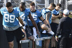 Jacksonville Jaguars tight end Tim Tebow, left, works out will his fellow tight ends during NFL football training camp, Wednesday, July 28, 2021, at the team's practice fields outside TIAA Bank Field in Jacksonville, Fla. (Bob Self/The Florida Times-Union via AP)