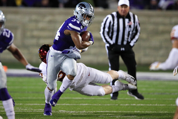 Kansas State running back James Gilbert (34) breaks away from Iowa State linebacker Mike Rose (23) during the second half of an NCAA college football game in Manhattan, Kan., Saturday, Nov. 30, 2019. (AP Photo/Orlin Wagner)