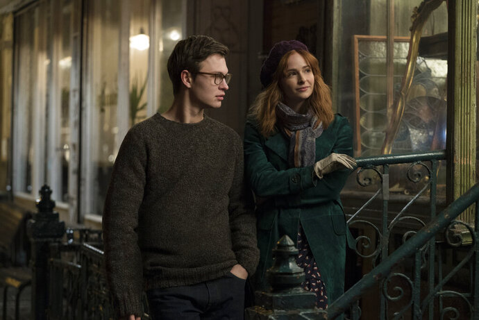 This image released by Warner Bros. Pictures shows Ansel Elgort, left, and Ashleigh Cummings in a scene from