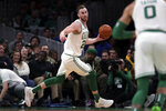 Boston Celtics forward Gordon Hayward looks to pass during the first half of an NBA basketball game against the Cleveland Cavaliers in Boston, Monday, Dec. 9, 2019. (AP Photo/Charles Krupa)