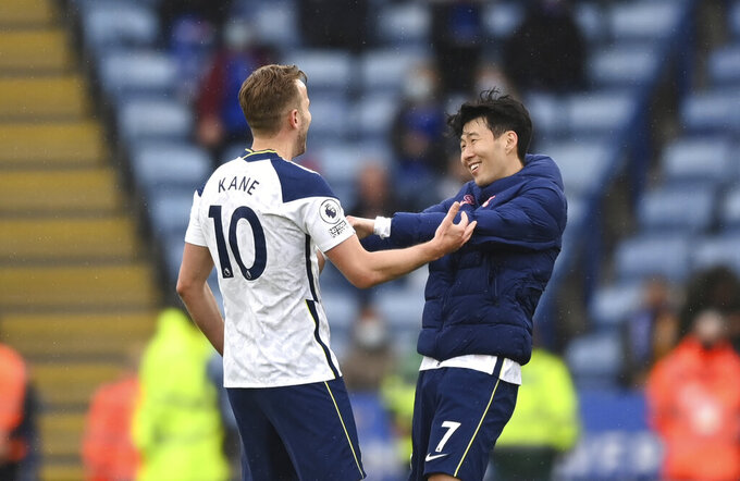 Tottenham's Harry Kane, left, hugs Tottenham's Son Heung-min at the end of the English Premier League soccer match between Leicester City and Tottenham Hotspur at the King Power Stadium, in Leicester, England, Sunday, May 23, 2021.(Shaun Botterill/Pool via AP)