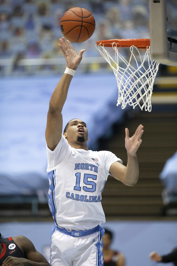 North Carolina's Garrison Brooks shoots during the first half against Northeastern in an NCAA college basketball game Wednesday, Feb. 17, 2021, in Chapel Hill, N.C. (Robert Willett/The News & Observer via AP)