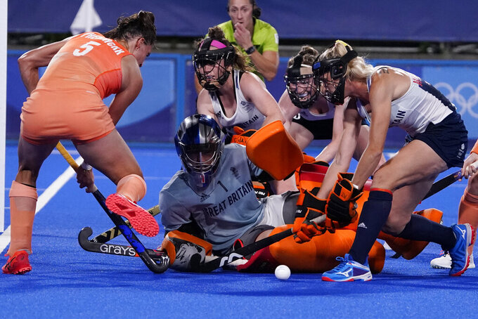 Britain's Claire Hinch (1) blocks a shot by Netherlands' Malou Pheninckx (5) during a women's field hockey match at the 2020 Summer Olympics, Thursday, July 29, 2021, in Tokyo, Japan. (AP Photo/John Locher)