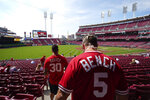 Cincinnati fans find their seats at Great American Ball Park before a baseball game between the Cincinnati Reds and the Pittsburgh Pirates in Cincinnati, Tuesday, April 7, 2021. (AP Photo/Bryan Woolston)