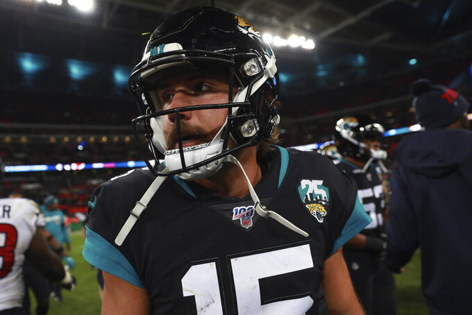 Jacksonville Jaguars quarterback Gardner Minshew leaves the field after an NFL football game against the Houston Texans, at Wembley Stadium, Sunday, Nov. 3, 2019, in London. The Houston Texans won 26-3. (AP Photo/Ian Walton)