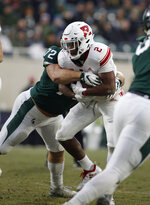 Rutgers' Raheem Blackshear (2) is stopped by Michigan State's Mike Panasiuk during the first quarter of an NCAA college football game, Saturday, Nov. 24, 2018, in East Lansing, Mich. (AP Photo/Al Goldis)