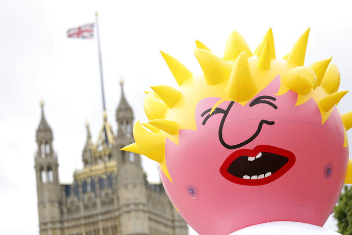 A view of a blimp depicting Boris Johnson that will be launched in Parliament Square, ahead of a pro-European Union march organised by March for Change, in London, Saturday July 20, 2019. (Aaron Chown/PA via AP)
