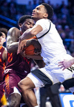 Wake Forest guard Brandon Childress, right, is tied up by Virginia Tech guard Tyrece Radford during an NCAA college basketball game against Virginia Tech Tuesday, Jan. 14, 2020 in Winston-Salem, N.C. (Andrew Dye/Winston-Salem Journal via AP)