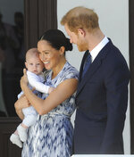 FILE - In this Wednesday, Sept. 25, 2019 file photo Britain's Prince Harry and Meghan, Duchess of Sussex, holding their son Archie, meet Anglican Archbishop Emeritus, Desmond Tutu and his wife Leah in Cape Town, South Africa. The Duchess of Sussex has revealed that she had a miscarriage in July. Meghan described the experience in an opinion piece in the New York Times on Wednesday. She wrote: