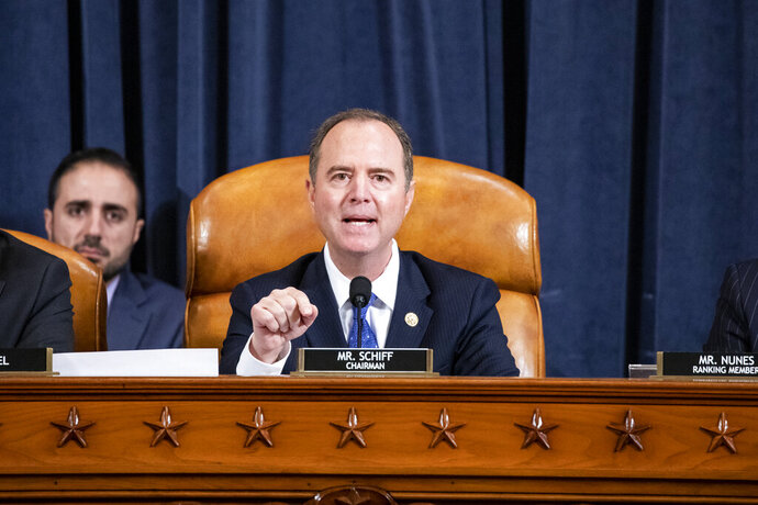 House Intelligence Committee Chairman Adam Schiff, D-Calif., gives his closing remarks as U.S. Ambassador to the European Union Gordon Sondland testifies before the House Intelligence Committee on Capitol Hill in Washington, Wednesday, Nov. 20, 2019, during a public impeachment hearing of President Donald Trump's efforts to tie U.S. aid for Ukraine to investigations of his political opponents. (Samuel Corum/Pool Photo via AP)