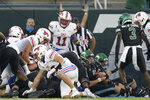 Tulane quarterback Michael Pratt (7), bottom right, scores a touchdown during an NCAA college football game against SMU in New Orleans, Friday, Oct. 16, 2020. (AP Photo/Matthew Hinton)