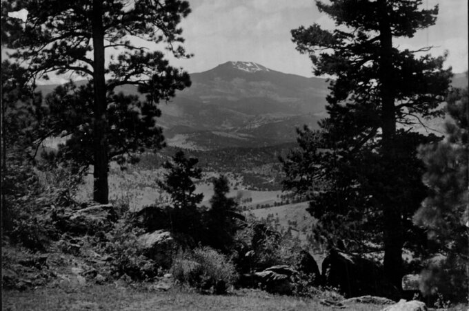 Squaw Mountain is shown framed in evergreens on July 27, 1927, in Colorado. A Colorado state panel has recommended on Thursday, Sept. 16, 2021, that a peak west of Denver, Squaw Mountain be renamed to Mestaa'ėhehe Mountain after a Cheyenne woman who facilitated relations between white settlers and Native American tribes in the early 19th century. The recommendation comes amid national efforts to address a history of colonialism and oppression against Native Americans and other people of color. (The Denver Post via AP)