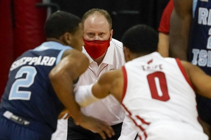 Wisconsin head coach Greg Gard watches during the first half of an NCAA college basketball game against Rhode Island Wednesday, Dec. 9, 2020, in Madison, Wis. (AP Photo/Morry Gash)