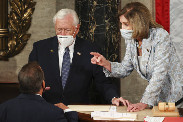 House Majority Leader Steny Hoyer, D-Md., and Speaker of the House Nancy Pelosi of Calif., speak during votes on opening day of the 117th Congress at the U.S. Capitol in Washington, Sunday, Jan. 3, 2021. (Tasos Katopodis/Pool via AP)