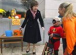 In this Friday, Oct. 25, 2019 photo, Sen. Susan Collins, R-Maine, hands out candy to children outside her office during a tricks-or-treat event hosted by the local chamber of commerce in Lewiston, Maine. Collins is expected to make a formal announcement on her reelection plans later this fall. (AP Photo/David Sharp)