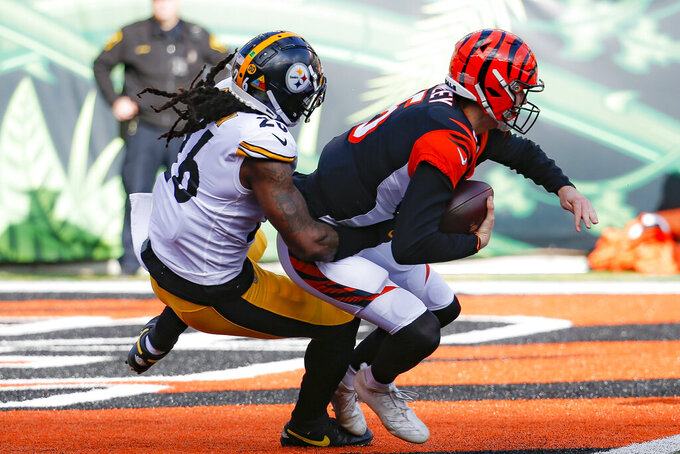 Pittsburgh Steelers inside linebacker Mark Barron (26) sacks Cincinnati Bengals quarterback Ryan Finley (5) during the first half an NFL football game, Sunday, Nov. 24, 2019, in Cincinnati. (AP Photo/Frank Victores)