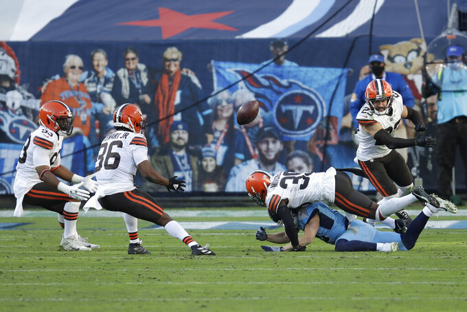 Cleveland Browns cornerback M.J. Stewart (36) intercepts a pass after cornerback Terrance Mitchell (39) knocked it out of the hands of Tennessee Titans wide receiver Adam Humphries, on the ground, in the second half of an NFL football game Sunday, Dec. 6, 2020, in Nashville, Tenn. (AP Photo/Ben Margot)