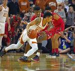 Texas guard Elijah Mitrou-Long, front, drives the ball against Texas Tech guard Jarrett Culver during the first half of an NCAA college basketball game, Saturday, Jan. 12, 2019, in Austin, Texas. (AP Photo/Michael Thomas)