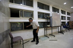 A rabbi stands inside a Jewish religious school in Sderot, Israel, after it was hit by a rocket fired from the Gaza Strip, Thursday, June 13, 2019. (AP Photo/Tsafrir Abayov)