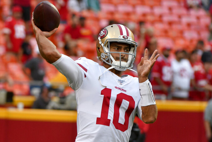 San Francisco 49ers quarterback Jimmy Garoppolo warms up before an NFL preseason football game against the Kansas City Chiefs in Kansas City, Mo., Saturday, Aug. 24, 2019. (AP Photo/Ed Zurga)
