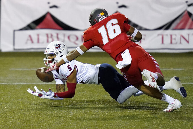 Fresno State wide receiver Jalen Cropper (5) catches a touchdown pass underneath New Mexico safety Tavian Combs (16) during the first half of an NCAA college football game Saturday, Dec. 12, 2020, in Las Vegas. (AP Photo/John Locher)