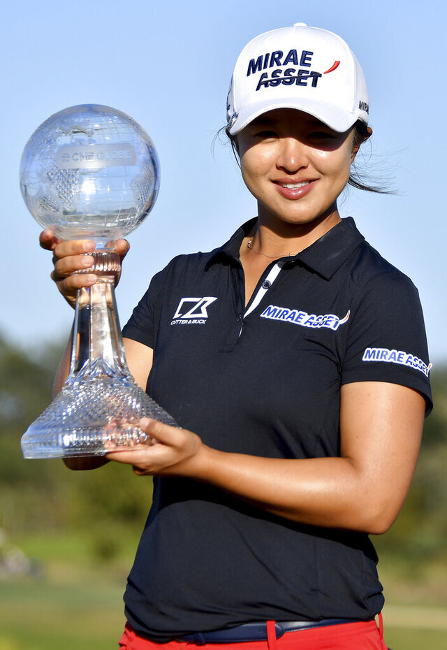 Sei Young Kim with The 2019 CME Group Tour Championship trophy at the Tiburón Golf Club in Naples, Fla. Sunday, Nov. 24, 2019. (Chris Tilley/Naples Daily News via AP)