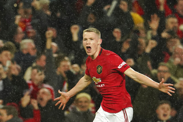 Manchester United's Scott McTominay celebrates after scoring his side's second goal during the English Premier League soccer match between Manchester United and Manchester City at Old Trafford in Manchester, England, Sunday, March 8, 2020. (AP Photo/Dave Thompson)