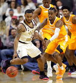 Texas A&M guard TJ Starks, left, recovers the ball in front of Tennessee guard Jordan Bone (0) during the first half of an NCAA college basketball game Saturday, Feb. 2, 2019, in College Station, Texas. (AP Photo/Michael Wyke)