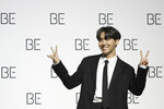 A member of South Korean K-pop band BTS, J-Hope poses for photographers during a press conference to introduce their new album