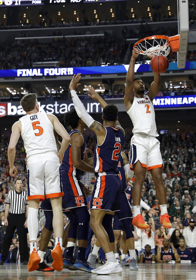 Virginia's Braxton Key (2) dunks during the first half in the semifinals of the Final Four NCAA college basketball tournament against Auburn, Saturday, April 6, 2019, in Minneapolis. (AP Photo/Jeff Roberson)