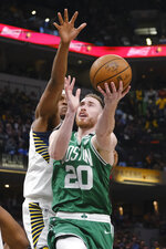 Boston Celtics forward Gordon Hayward (20) shoots in front of Indiana Pacers center Myles Turner during the second half of an NBA basketball game in Indianapolis, Tuesday, March 10, 2020. The Celtics won 114-111. (AP Photo/AJ Mast)